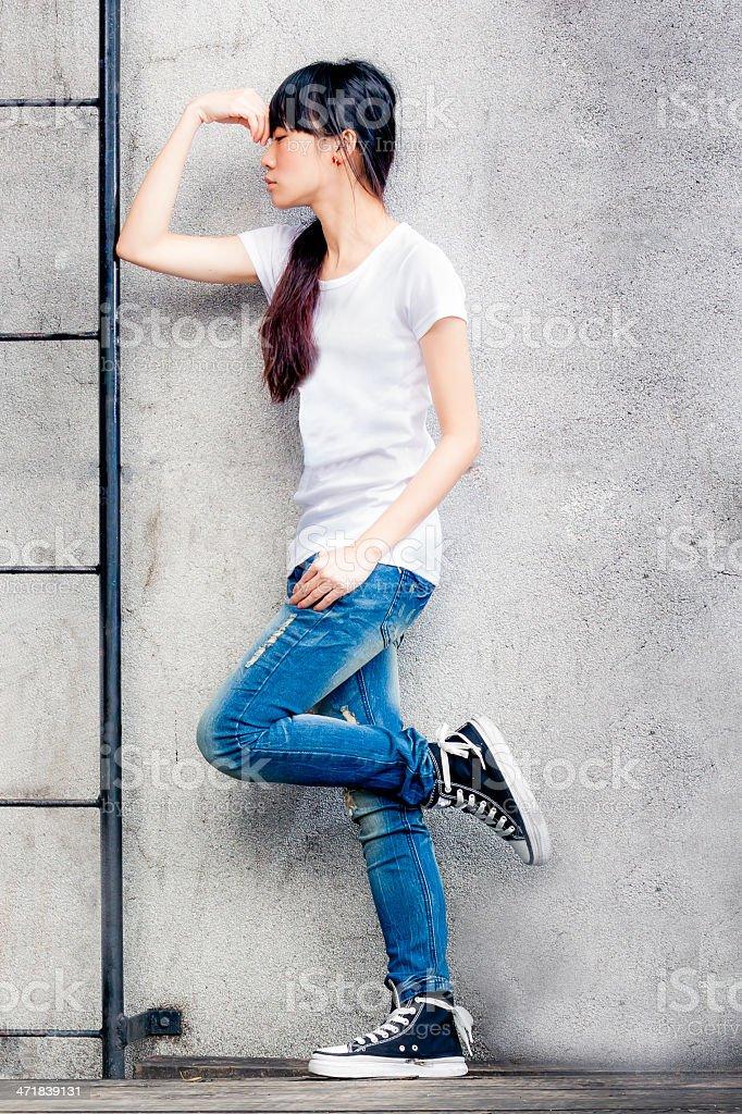 Asian girl on ladder