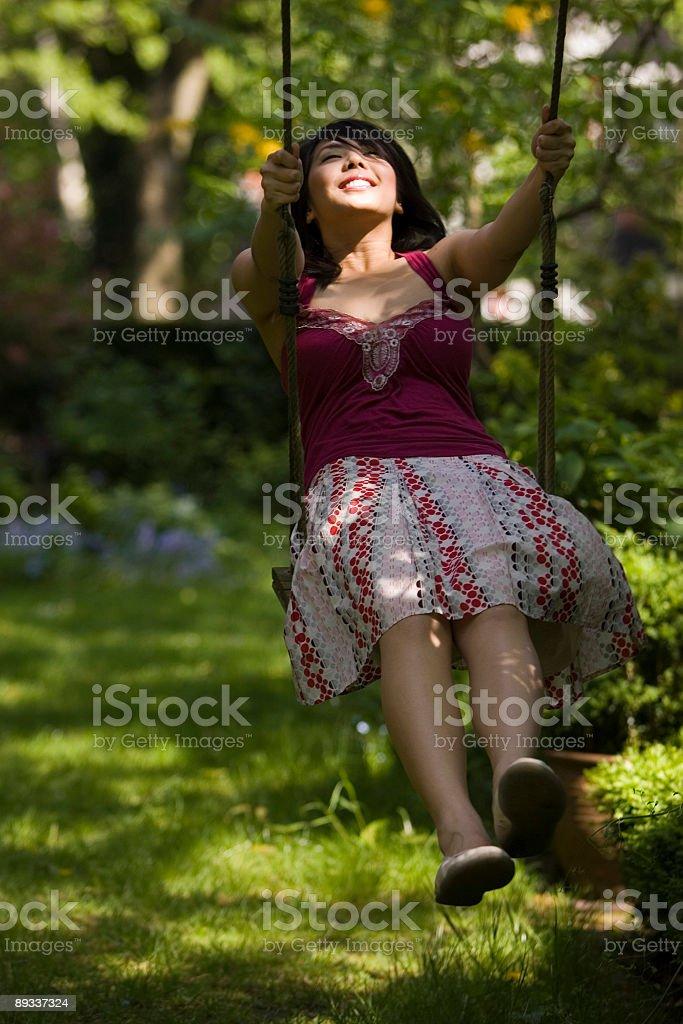 asian girl on garden swing royalty-free stock photo