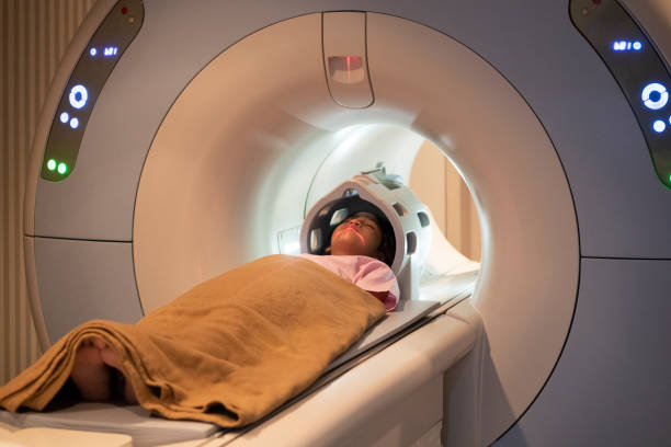 Asian girl on MRI scanner stock photo