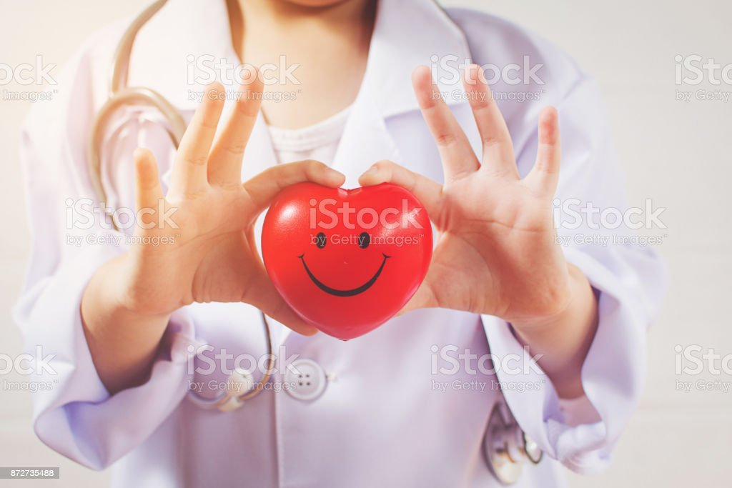 Asian girl playing as a doctor care healthy heart