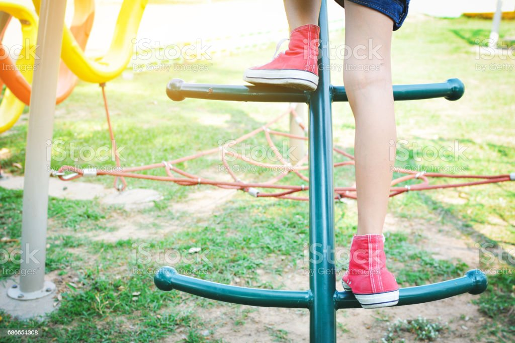 Asian girl playing in playground happy on holiday selective and soft focus photo libre de droits