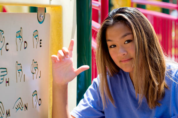 Asian girl practices the L sign stock photo