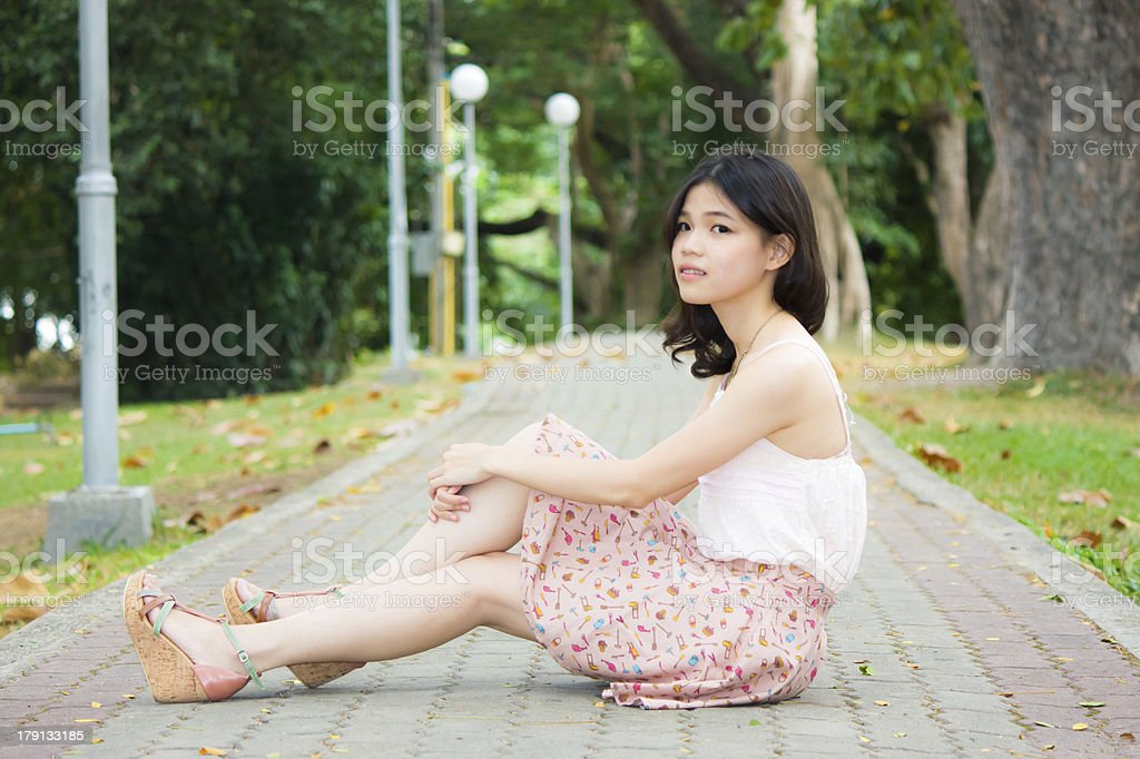 Asian girl relaxing on the floor stock photo