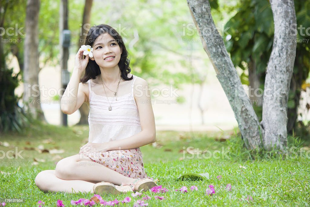 Asian girl relaxing on the grass stock photo