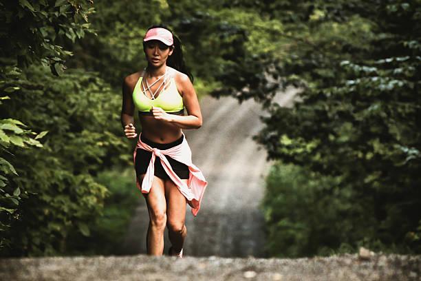 asian girl run to stay in shape - jogging hill bildbanksfoton och bilder
