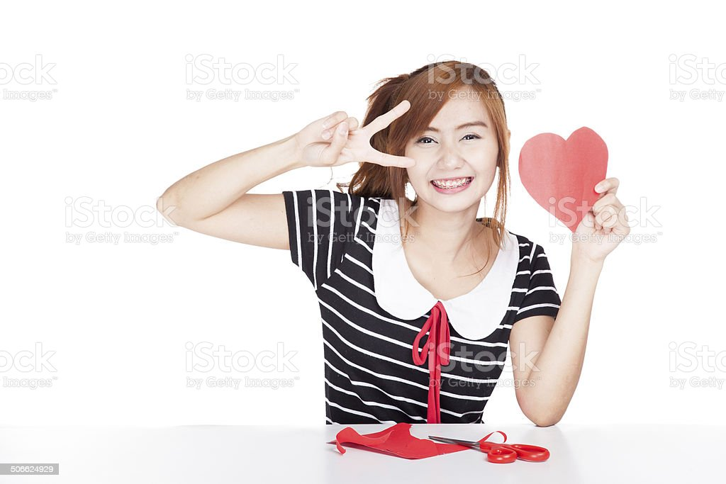 Asian girl show victory sign with heart shape paper royalty-free stock photo