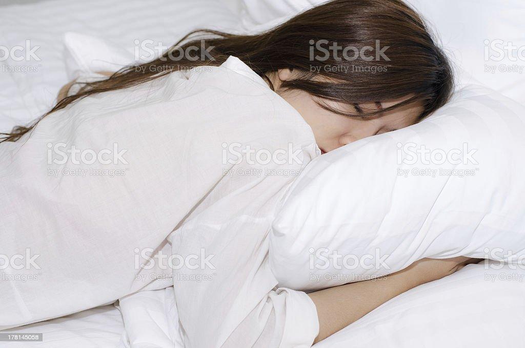 asian girl sleeping stock photo
