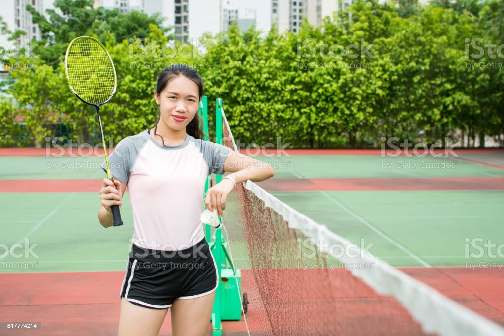 Asian girl standing on the badminton court stock photo
