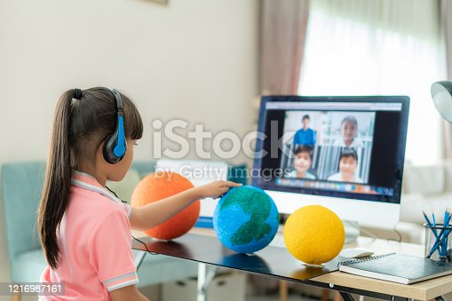 istock Asian girl student live learning video conference with teacher and other classmates giving presentation, showing solar model project, Homeschooling and distance learning ,online ,education and internet. 1216987161