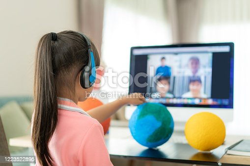 istock Asian girl student live learning video conference with teacher and other classmates giving presentation, showing solar model project, Homeschooling and distance learning ,online ,education and internet. 1223522895