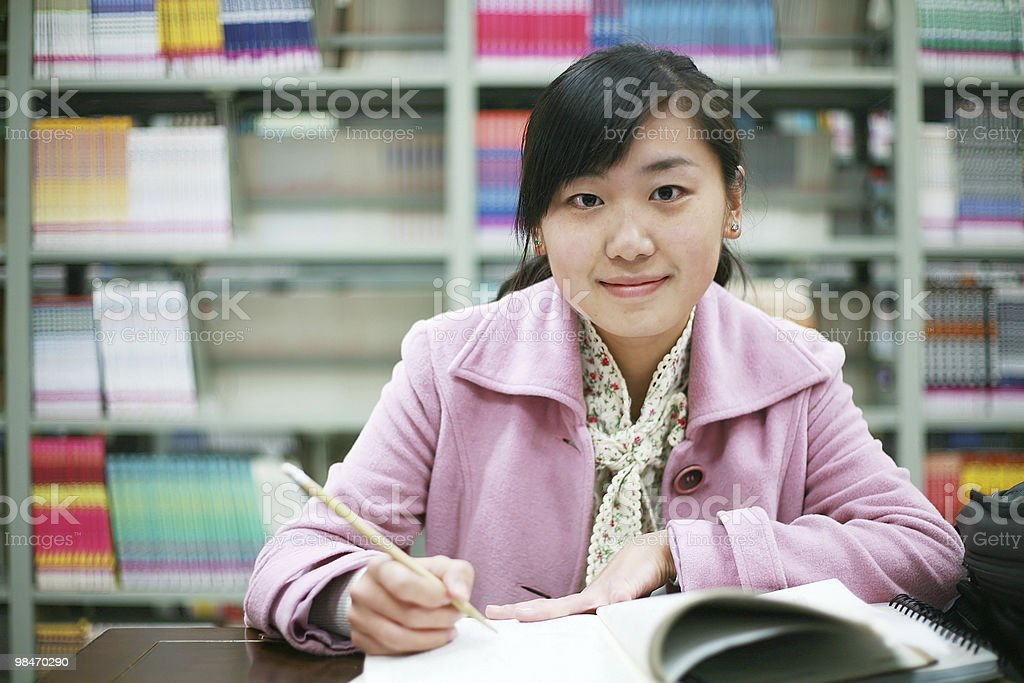 asian girl studying in library royalty-free stock photo