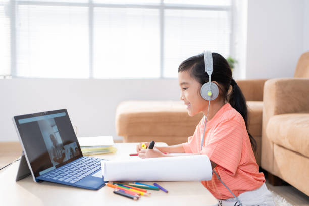 Asian girl Studying online with teacher Students are at home stock photo