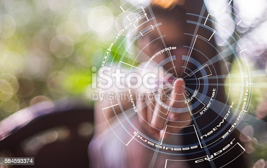 istock Asian girl touching the screen of hi technology device. 584593374