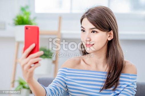 851960142istockphoto Asian girl use biometric access 1131563372