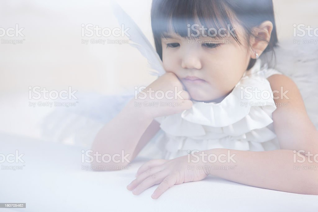 Asian girl with angel's wings royalty-free stock photo