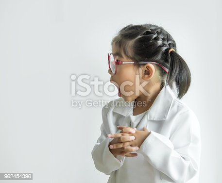 istock asian girl with big glass and science suite action on white screen 962454396