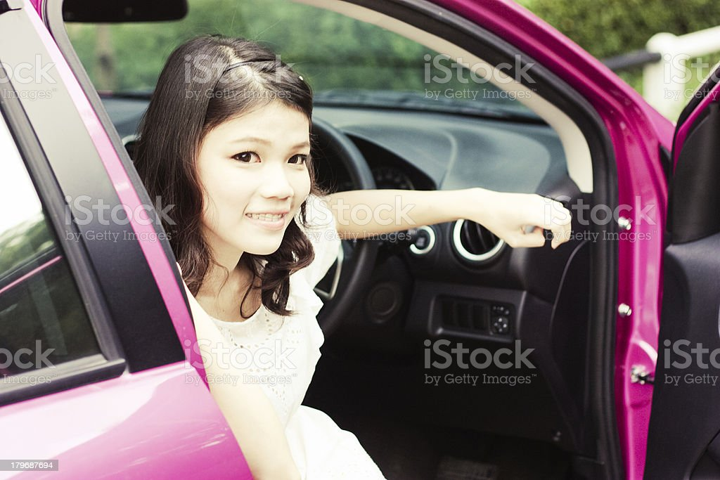 Asian girl with car outdoor stock photo