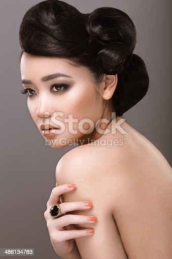 istock Oriental girl with evening hairstyle 486134783