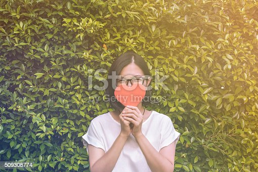 istock asian girl with eye glasses, take a heart 509308774