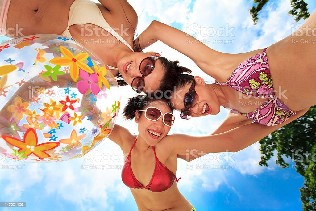 asian girls have fun under the sun royalty-free stock photo