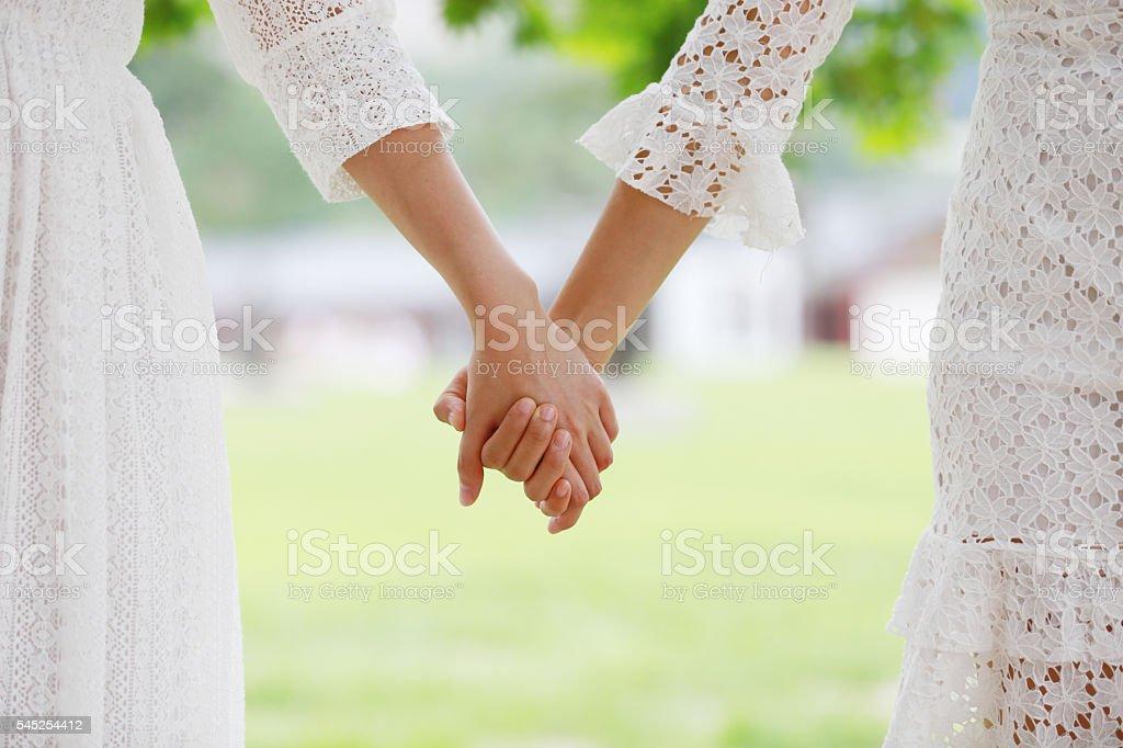 Asian girls holding hands stock photo