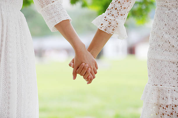 Asian girls holding hands Asian girls holding hands  gay person stock pictures, royalty-free photos & images