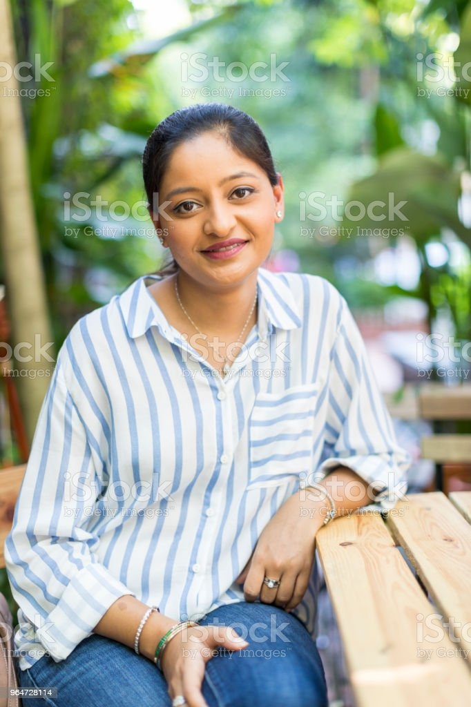 Asian Girl's Portrait from an outdoor cafe royalty-free stock photo