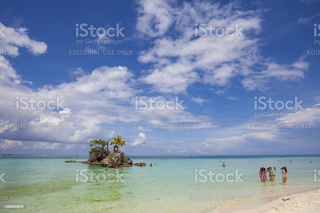 Asian girls take photos on the beach at Boracay royalty-free stock photo