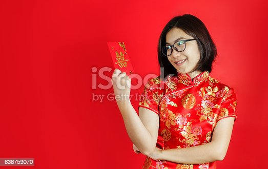 Chinese new year. Asian glasses woman with cheongsam holding red envelope on red background. Girl is smiling.