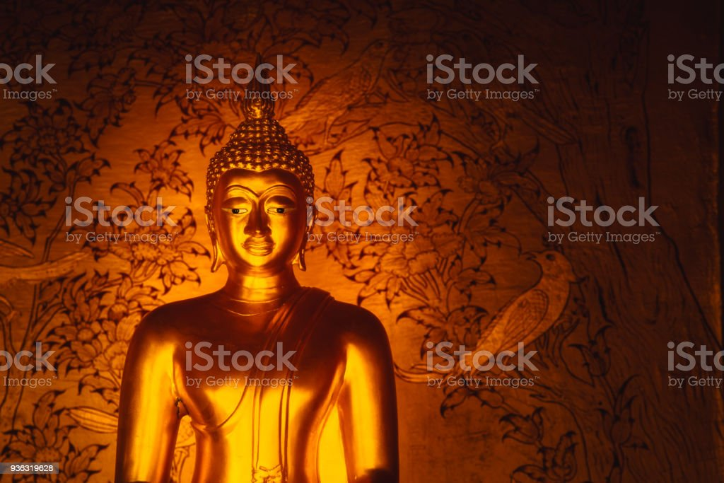 Asian Golden Buddha sign of peace in Thai Temple space for text stock photo