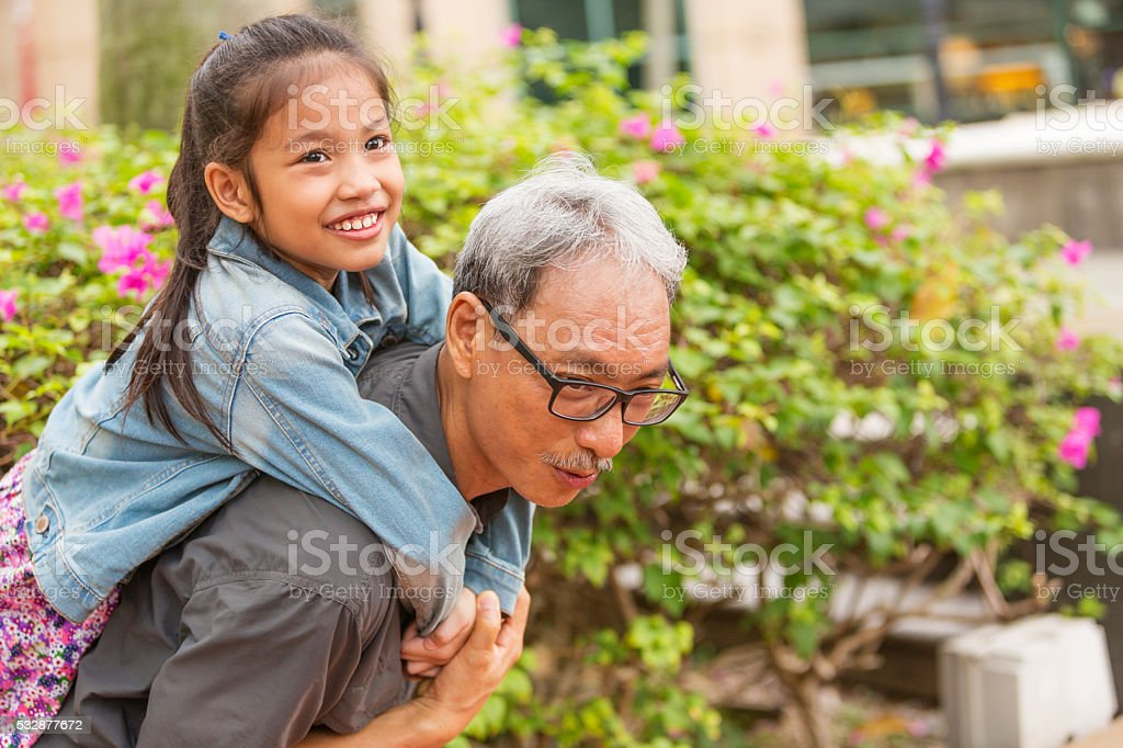 Asian Grandfather and Grandchild Playing stock photo