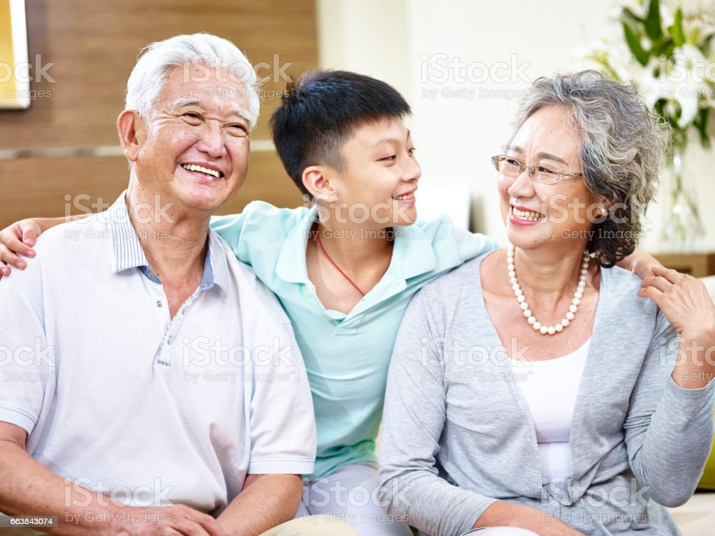asian grandparents and grandson stock photo
