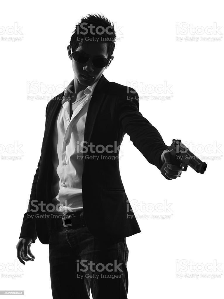 asian gunman killer portrait shooting silhouette stock photo