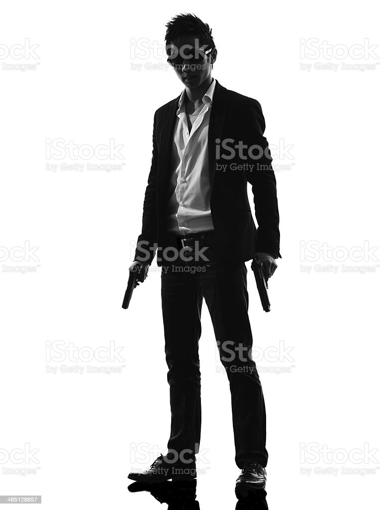 asian gunman killer standing silhouette stock photo