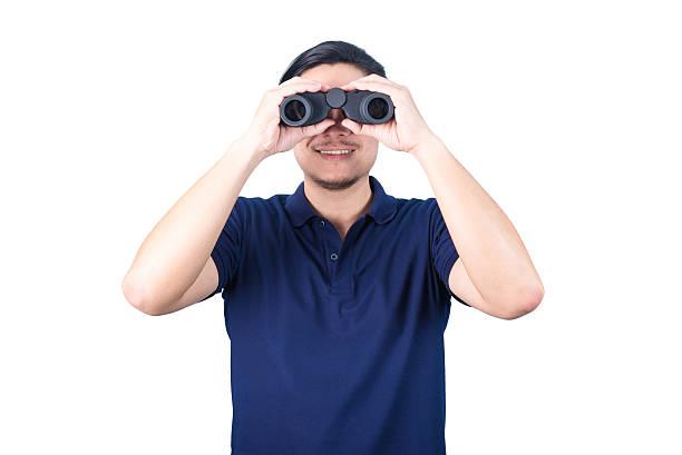 Asian guy holding binoculars, isolated on a white background. stok fotoğrafı