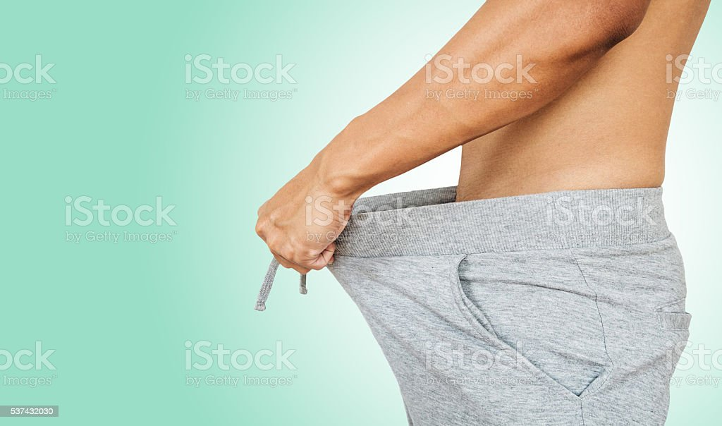 Asian guy pulling warm pant. with copy space stock photo