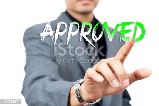 istock Asian handsome businessman write 'Approved