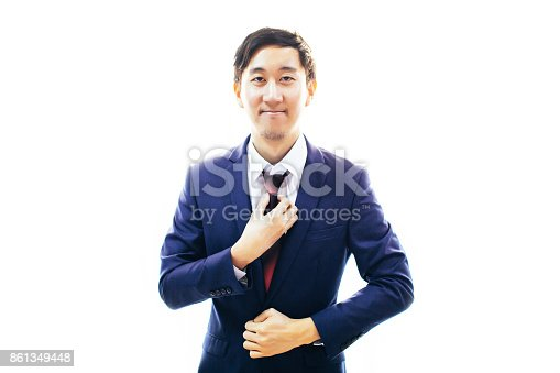 516141885istockphoto Asian handsome man dressing up in formal suit over white background with copy space 861349448