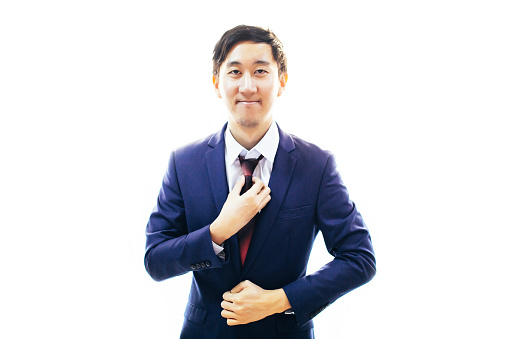 516141885 istock photo Asian handsome man dressing up in formal suit over white background with copy space 861349448