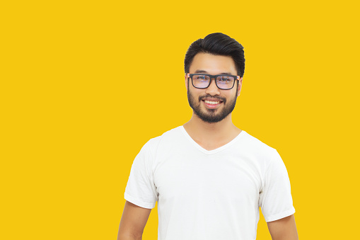 Asian handsome man with a mustache, smiling and laughing isolated on yellow background