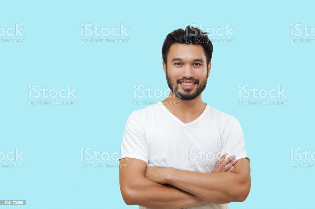 Asian handsome man with a mustache, smiling and laughing isolated on white background stock photo
