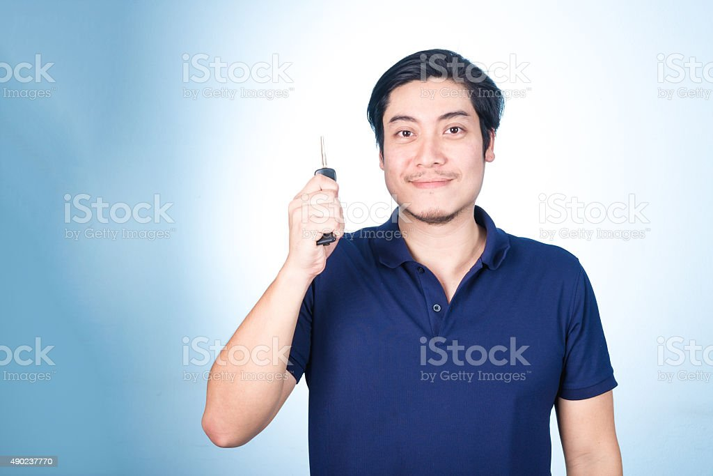 Asian handsome man with the keys of his new car stock photo