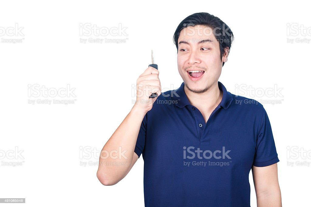 Asian handsome man with the keys of new car, isolated stock photo