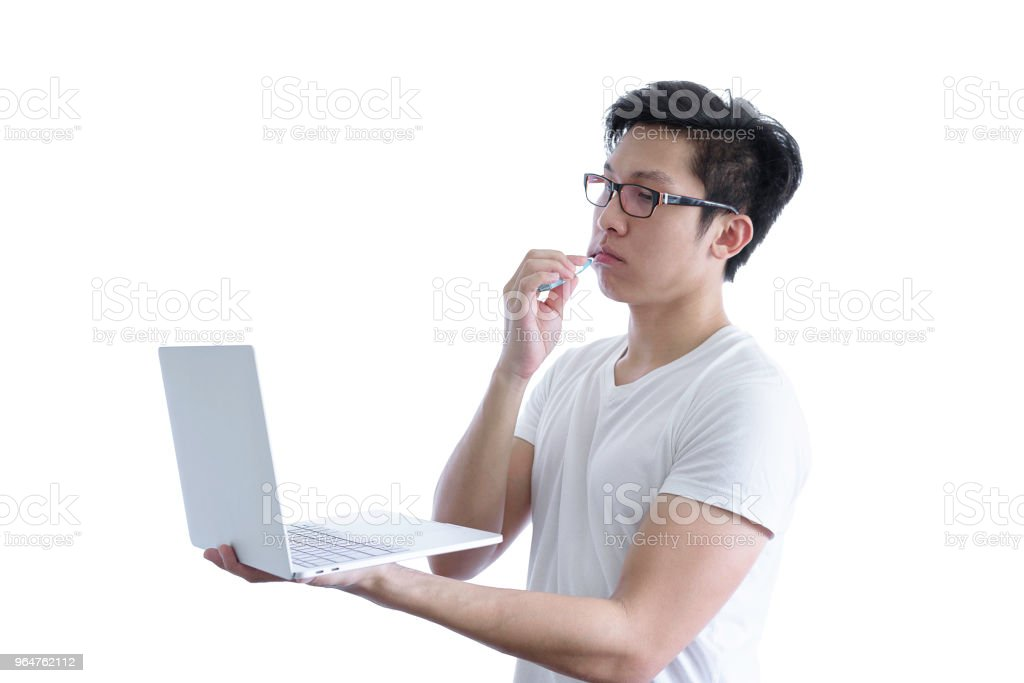 Asian handsome man with white shirt has wake up and  sleepy with tooth brush and working by holding laptop before going to start the work in the morning isolated on white background and clipping paths. royalty-free stock photo