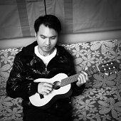 istock Asian handsome musician plays a children guitar 478252961