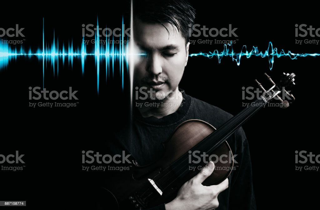 asian handsome musician posing on violin with blue waveform for music recording technology concept stock photo