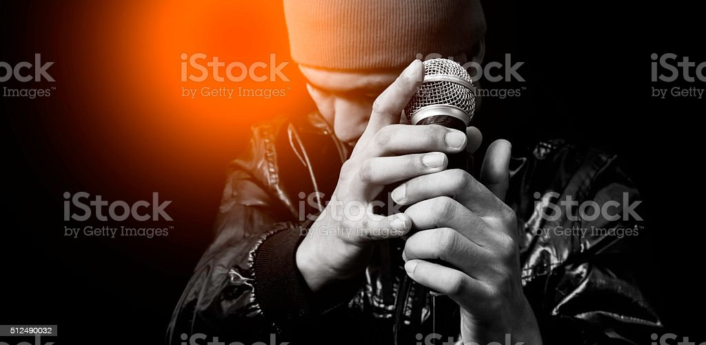asian handsome singer posing on dynamic microphone stock photo