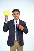 Asian handsome young business man holding concept bubble speech, isolated on white background, with copy space