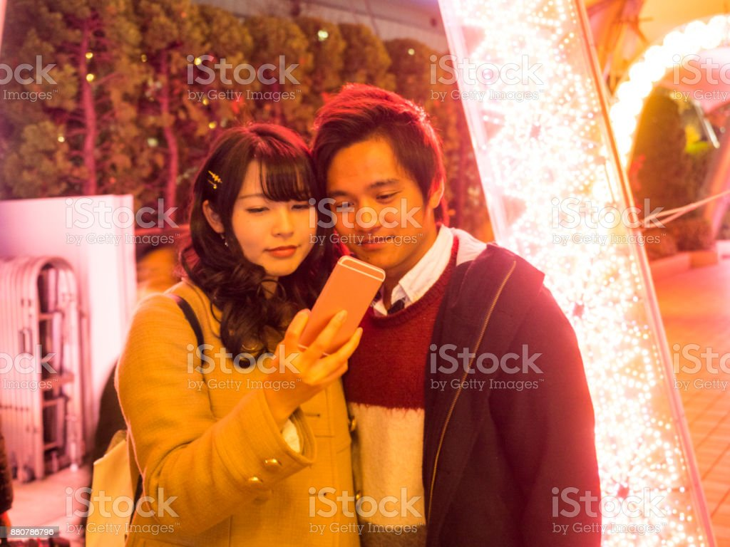 Asian high school students watching her smart phone. stock photo