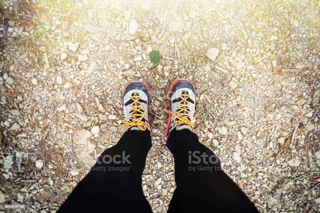 Asian hiker walking on trail in nature. stock photo